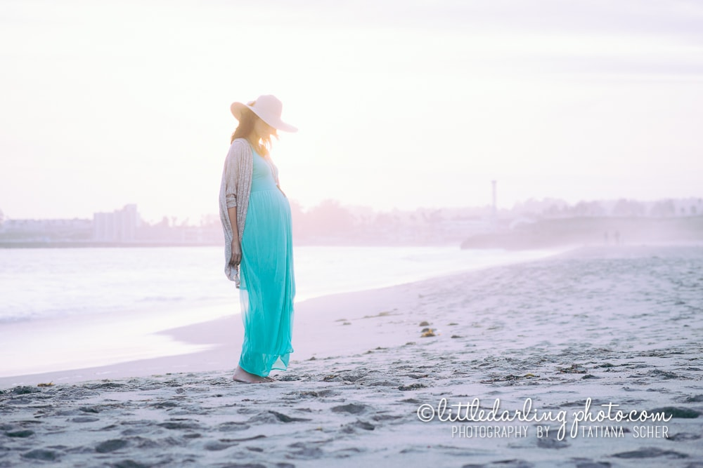 Beautiful pregnant woman on Seabright beach
