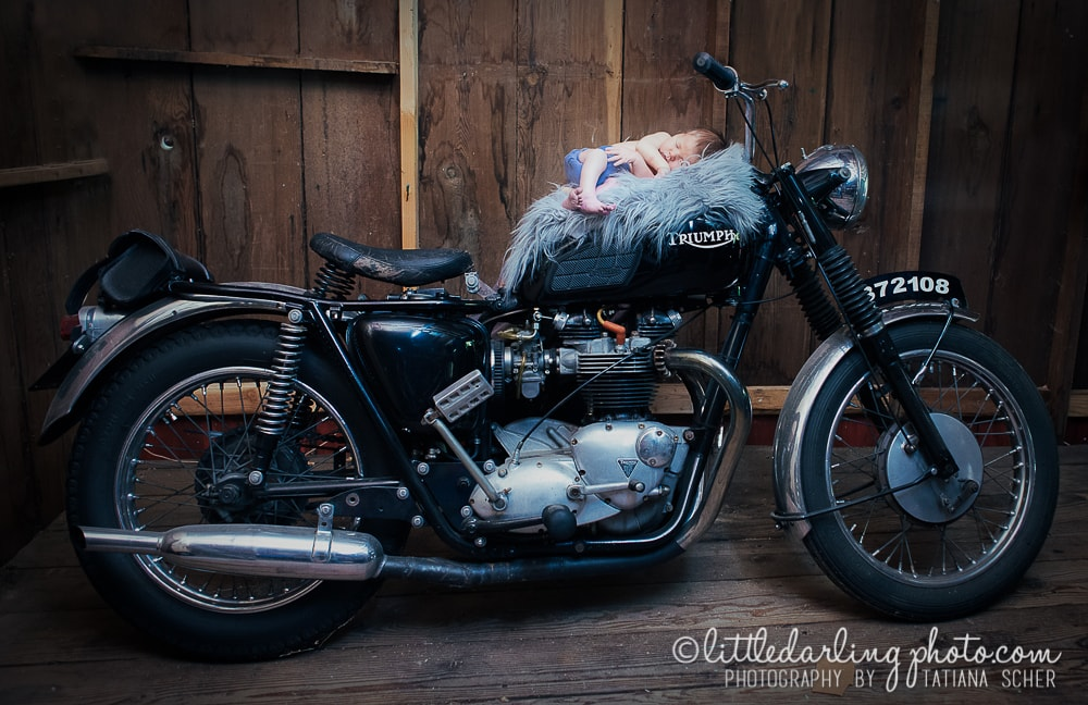 Newborn baby photo on a motorcycle