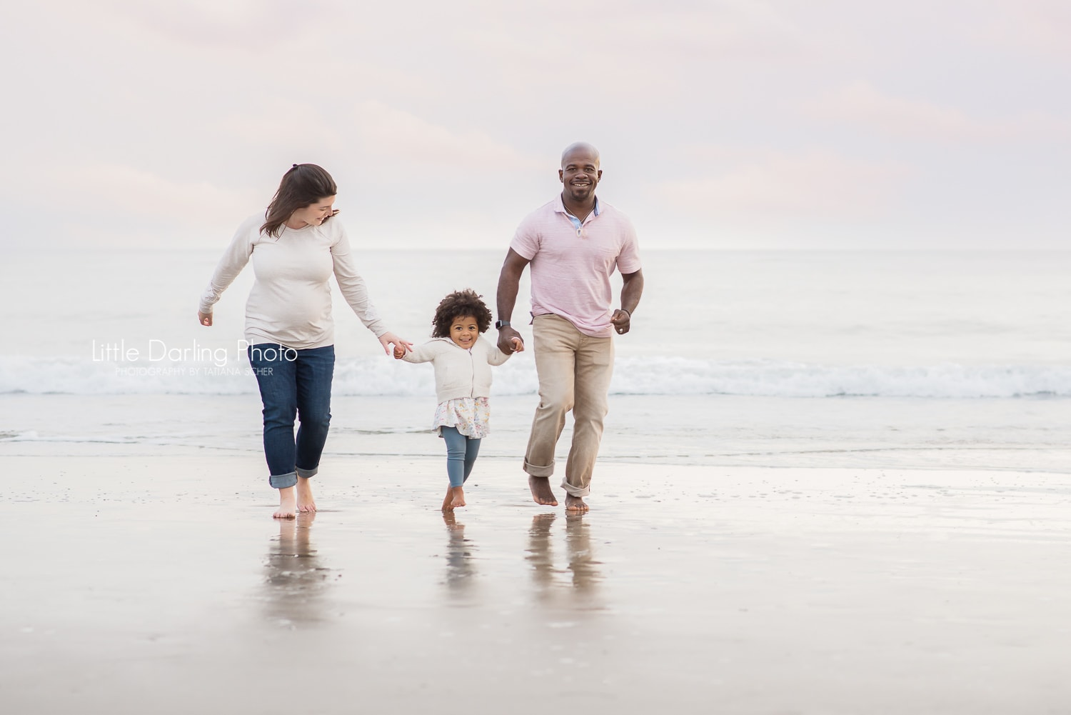 Pregnant woman and her family at the beach