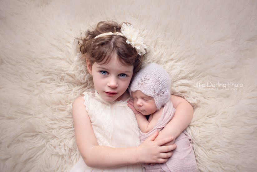 Newborn girl and her big sister