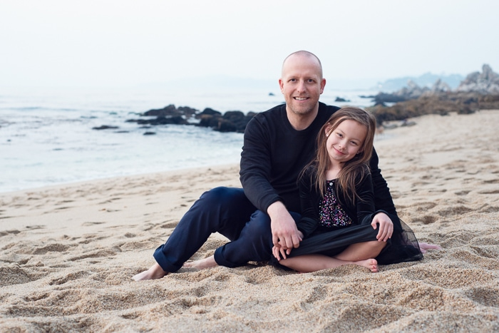Portrait of father and daughter in Monastery Beach, Big Sur