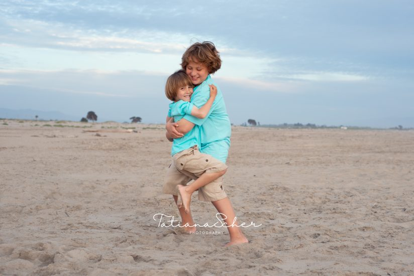 brothers playing at the beach
