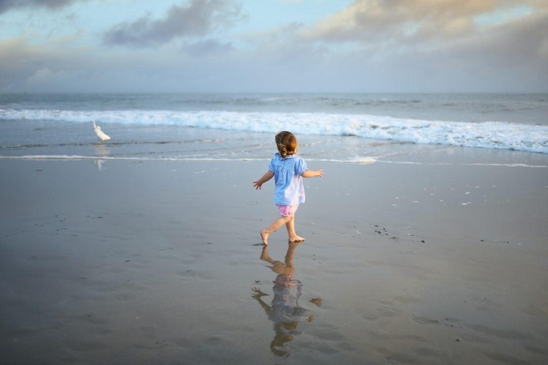 Girl playing sunset