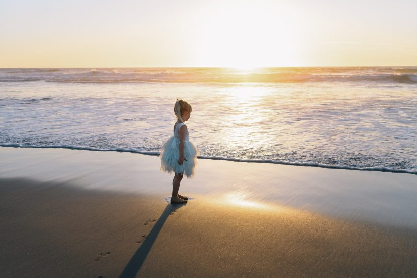 little girl by the ocean