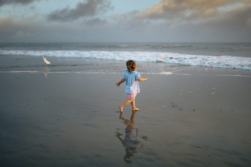 kid playing in the ocean